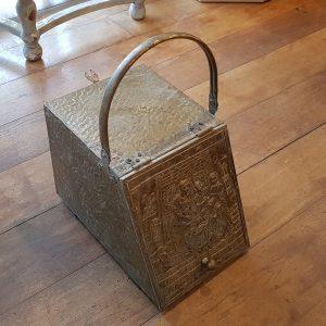 Antique brass coal storage