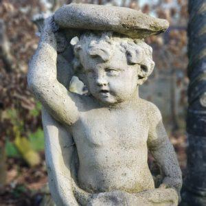 Composition stone cherub statue with eagle
