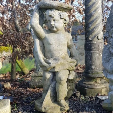 Composition stone putti statue