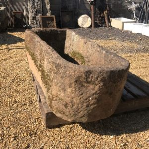 Gritstone trough with rounded ends
