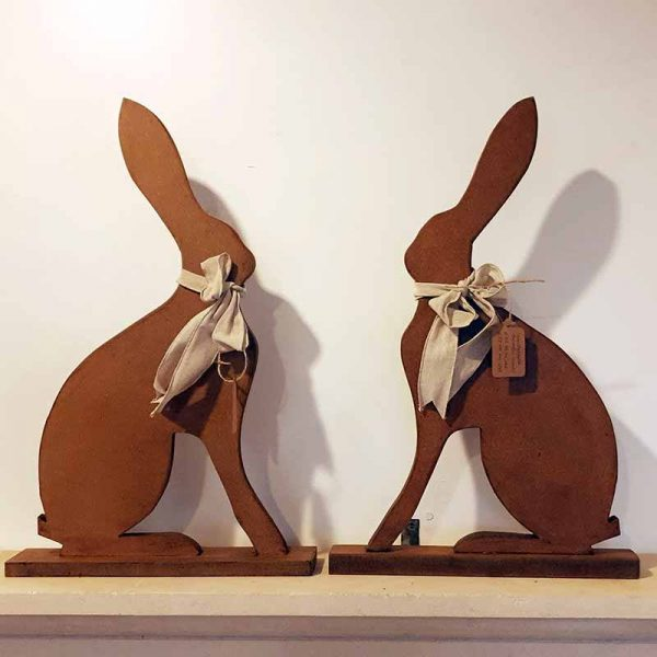 Handcarved wooden sitting hares ornament for country home