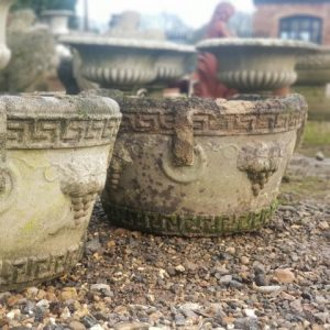 Pair of reclaimed greek key and grapes stone planters