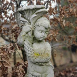 Reclaimed stone statue cherub holding cornucopia