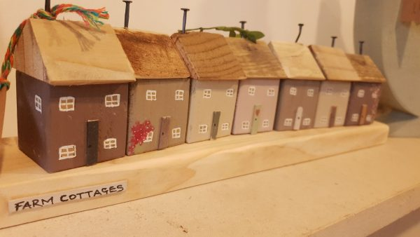 Row of Handmade Wooden Farm Cottages