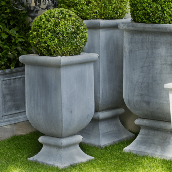 Small Zinc Urn Planter by a Place in the Garden