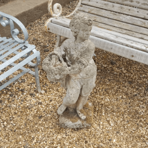 Statue boy with fruit basket side
