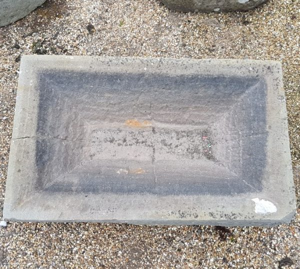 Shallow stone trough with drainage