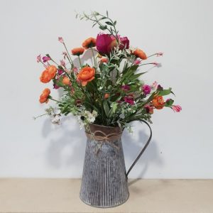 Hand arranged flower bouquet in zinc vase