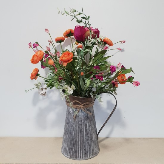 Hand arranged flower bouquet in zinc vase