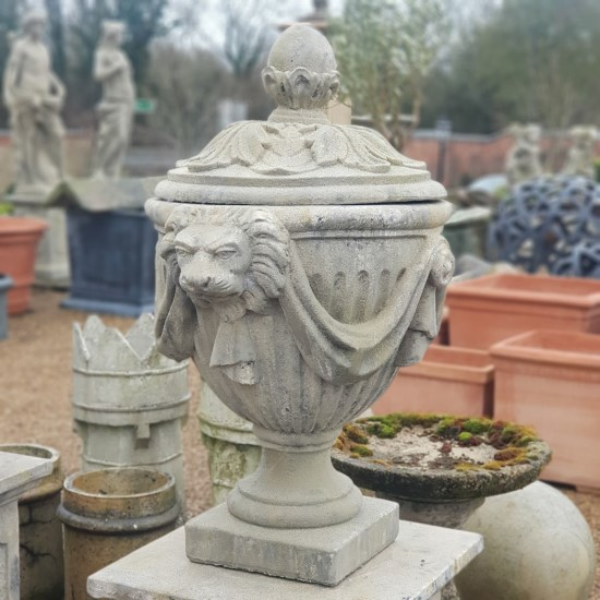 Lion head urn with draped fabrci