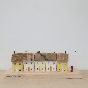 Yellow and white model wooden cottages