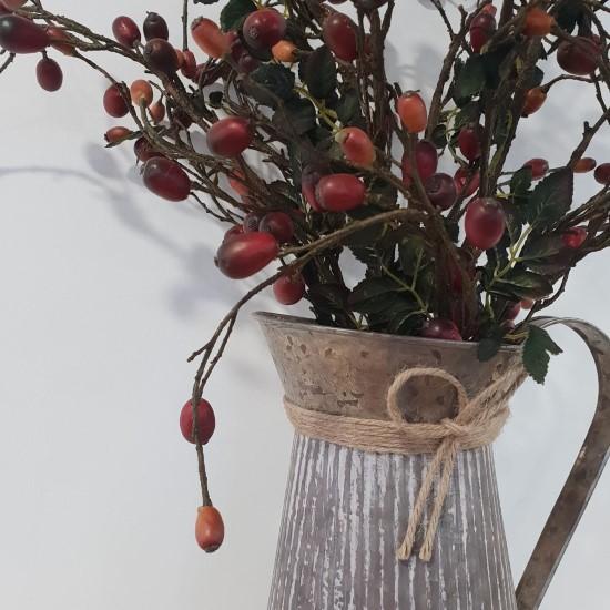 Zinc Jug of berries close up